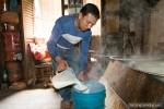 man pouring milk